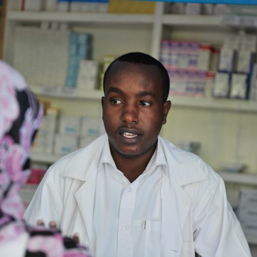 A staff member of the Blue Star Hospital talks to a pharmacist    in Mogadishu, Somalia on October 14 2015. It is the only  hospital in Somalia performs cancer investigations with mammography, radiology, endoscopies, fine needle biopsies and ultrasound-guided biopsies. AMISOM Photo / Ilyas Ahmed